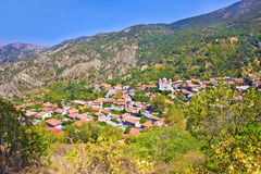Mountain Village Pedoulas, Cyprus. View over roofs of houses, mountains and Big church of Holy Cross. Village is one of most pictu Royalty Free Stock Image