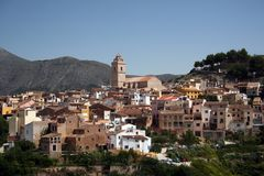 Mountain Village of Polop. The mountain village of Polop near Altea on the Spanish Costa Blanca. Viewed from across the valley at La Nucia stock photos