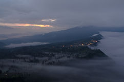 Mountain village in Probolinggo. Fog gy mountain village in probolinggo at dawn stock photo