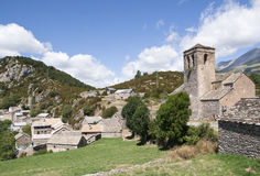 Mountain village, Pyrenees, Spain. General view of a small mountain village in the Aragonese Pyrenees Romanesque right from image church, Spain Stock Photos