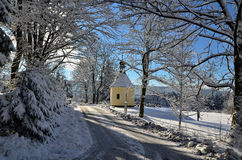 In the mountain village. Snowy February day at the chapel in the village in the mountains Royalty Free Stock Photography