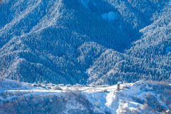 Mountain village on the snowy slope in Caucasus Royalty Free Stock Image