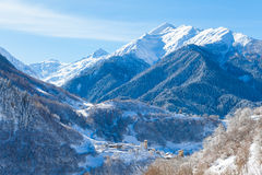 Mountain village on the snowy slope in Caucasus Stock Photos