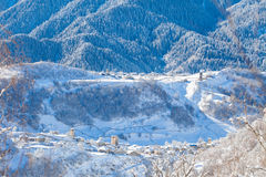 Mountain village on the snowy slope in Caucasus Royalty Free Stock Photography