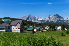 The village at the foot of the mountains. Unity with nature Royalty Free Stock Images