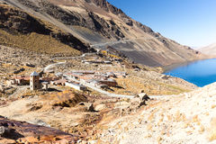Mountain village town stone buildings old abandoned houses, lake, Bolivia. Royalty Free Stock Photo
