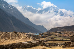 Mountain village under the snow-capped peaks in Gokio Valley. Hi. Mountain village under the snow-capped peaks in Gokio Valley. Nepal. Himalayas Stock Photography