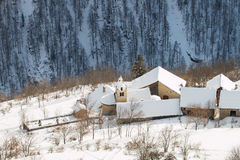 Mountain village under a thick layer of snow Royalty Free Stock Photo
