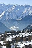 Mountain village verbier. View of verbier in the swiss alps on perfect crisp winters day, perspective compression from extreme telephoto lens stock images