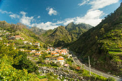 Mountain village view (1). Typical mountain village view of Madeira, Portugal. Tile roofs, white, light yellow and flaxen houses narrow (tight, restricted) roads royalty free stock images