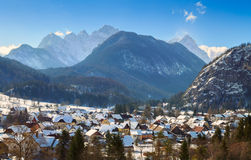 Mountain village, winter landscape with the Julian Alps. In Slovenia Stock Images