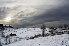 Mountain village in winter time. Mountain village covered with snow viewed from a higher position Stock Photography