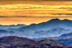 Mountain Vista and Yellow Sunrise. Major vista overlooking many mountains and a beautiful sunrise in Joshua Tree royalty free stock images