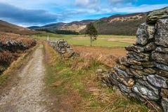Mountain walk along stone wall Stock Photos