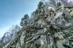 Mountain wall of rock. Mountain, wall of rock at the edge of the road Stock Photo