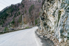 Mountain wall of rock. Mountain, wall of rock at the edge of the road Royalty Free Stock Photos