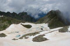 Mountain walley with frozen lake. Mountain walley in Caucasian moutains with frozen lake Stock Photos
