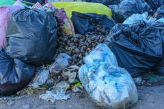 Mountain waste from urban society in underdeveloped countries. South East Asia. Mountain waste from urban society in underdeveloped countries Royalty Free Stock Photos