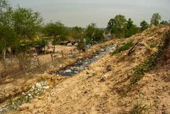 Mountain waste from urban society in underdeveloped countries. South East Asia. Mountain waste from urban society in underdeveloped countries Stock Photos