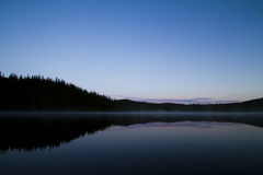 Mountain and water fog at twilight 3 Royalty Free Stock Image