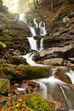 Mountain waterfall. Photo of peaceful flowing mountain waterfall Royalty Free Stock Photos