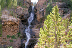 Mountain Waterfall. In the rugged mountains of Utah is the Uintah mountains. This is just one of many waterfalls that has carved out a chasm in the side of the royalty free stock photos
