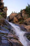 Mountain Waterfall. In the rugged mountains of Utah is the Uintah mountains. This is just one of many waterfalls that has carved out a chasm in the side of the royalty free stock photo