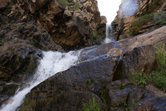 Mountain Waterfall. In the rugged mountains of Utah is the Uintah mountains. This is just one of many waterfalls that has carved out a chasm in the side of the royalty free stock image