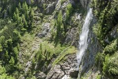 Mountain waterfall above the forest. In the sunlight, view from above Royalty Free Stock Photography