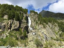 Free Mountain Waterfall Among The Rocks. Altai Mountains, Siberia, Russia Royalty Free Stock Images - 144137609