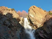 Mountain waterfall in autumn in clear weather. In Kazakhstan Royalty Free Stock Image