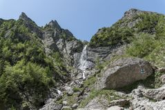 Mountain waterfall in a clear sunny day. Inspiring freshness and adventure Royalty Free Stock Photography