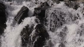 Mountain Waterfall Close Up. A close up of a scenic small mountain waterfall in Colorado in summer stock video footage