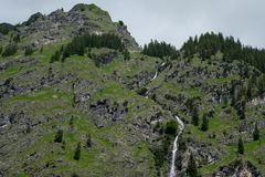 Mountain and waterfall with conifers and rocks. In Bavaria Germany Stock Photos