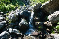 Mountain waterfall or creek on Alps. mountain natural landscape. stock photography