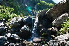 Mountain waterfall or creek on Alps. mountain natural landscape royalty free stock photography