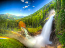Mountain Waterfall (Fantasy retouched). Retouched Fantasy Waterfall in Austria Royalty Free Stock Image