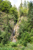 Mountain waterfall flowing among the steep slopes of the Rhodope Mountains Stock Images