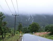 Mountain Waterfall and Foggy Stock Photo