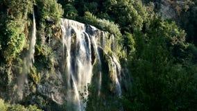 Mountain waterfall among greenery stock footage