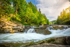 Mountain waterfall Guk in the wood. Ukrainian Carpathians. Mountainwaterfall Guk in the wood landscape. Ukrainian Carpathians Royalty Free Stock Images
