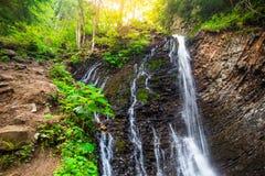 Mountain waterfall Guk in the wood. Ukrainian Carpathians. Mountainwaterfall Guk in the wood landscape. Ukrainian Carpathians Stock Photos