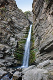 Mountain waterfall in the mountains of Tien Shan Royalty Free Stock Photography