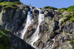 Mountain waterfall. The biggest Polish waterfall is located in Tatra Mountains, in one of the most picturesque valleys in whole mountain range royalty free stock images