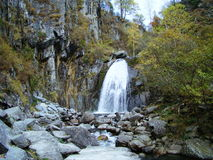 Mountain waterfall. Pure mountain water falls from a great height Stock Photo