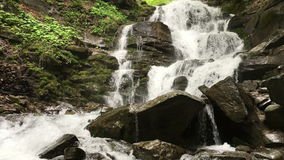 Mountain waterfall with a rocky bottom. Beautiful mountain waterfall with a rocky bottom in the woods stock video footage