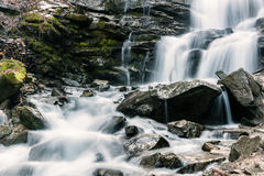 Mountain waterfall with rocky stones, nature background Royalty Free Stock Image