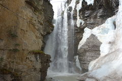 Mountain waterfall with snow and ice. Royalty Free Stock Image