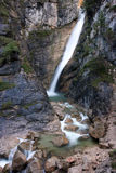 Mountain waterfall and stream. Serene, mountain waterfall and stream in slow-motion Stock Photography