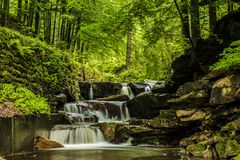 Mountain waterfall. Stream in Beskidy mountains, Poland royalty free stock photography